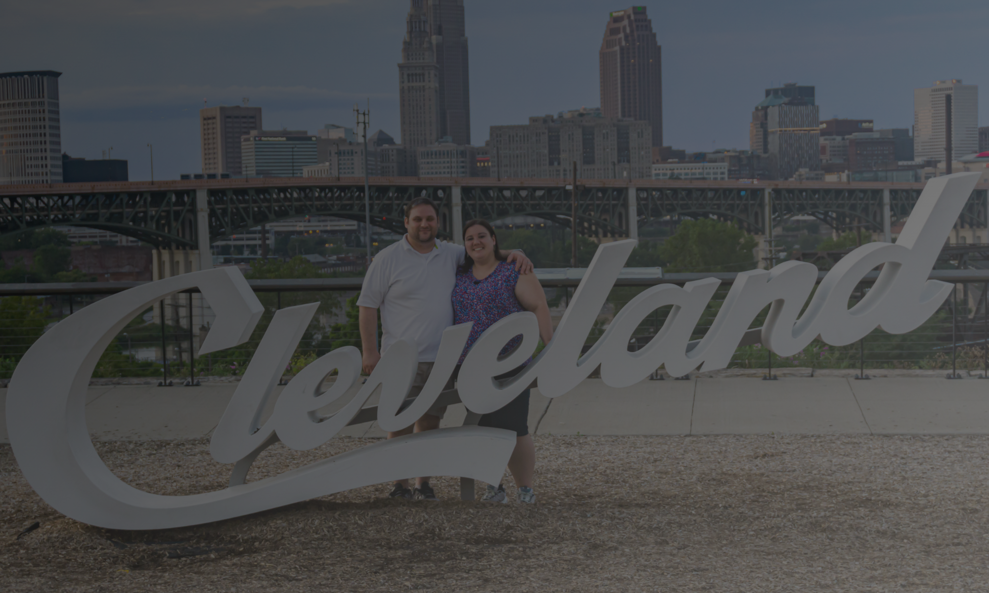 owners, Erica Larson and Malachi Witt at cleveland sign
