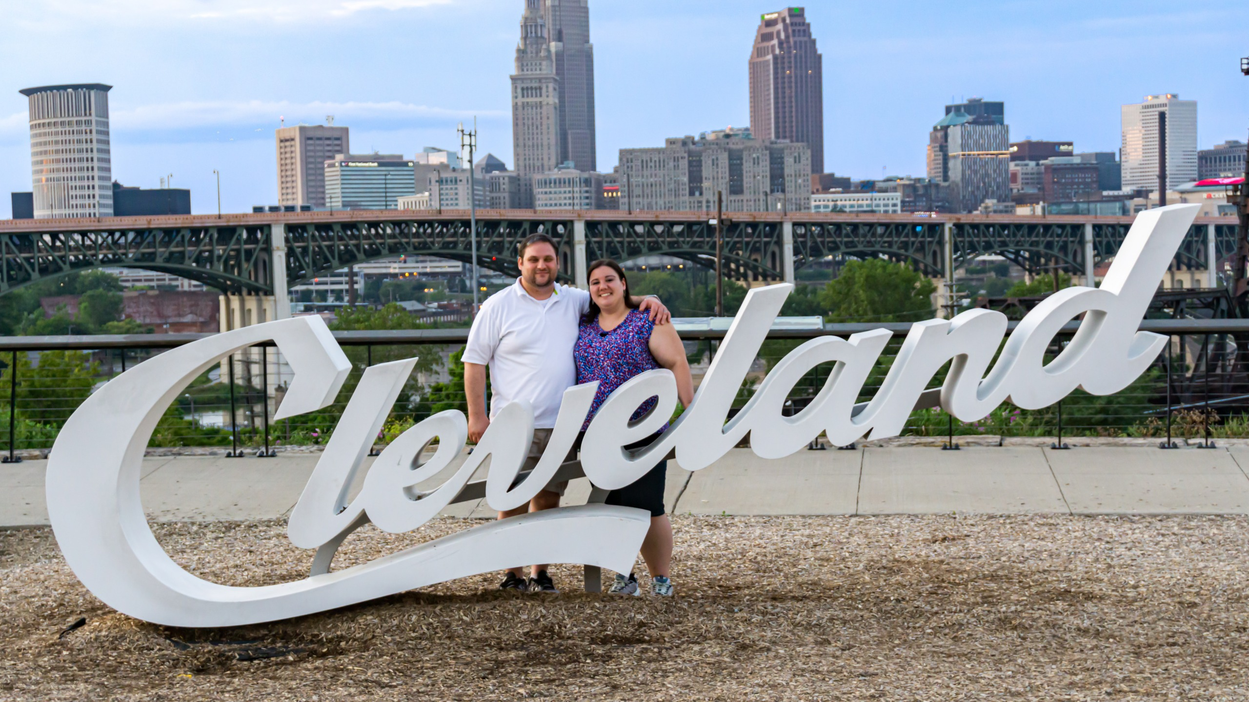 Erica and Malachi posing at a Cleveland sign